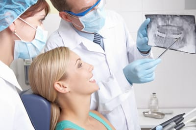 Woman and dentist looking at x-rays