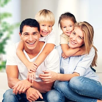 Smiling family with healthy teeth relaxing at home