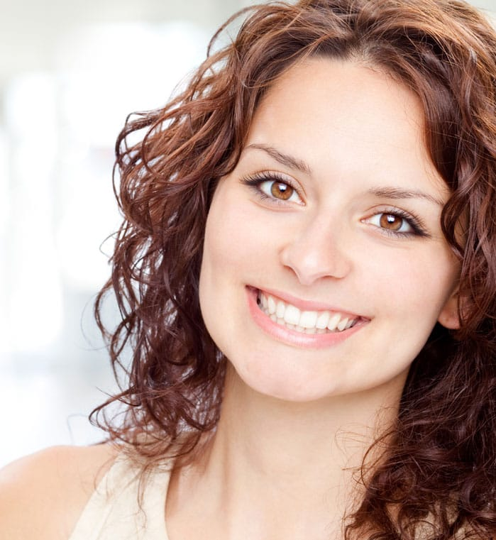 Woman sharing beautiful smile with porcelain veneers