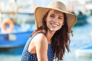 woman smiling in straw hat