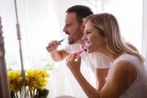 Couple brushing together.
