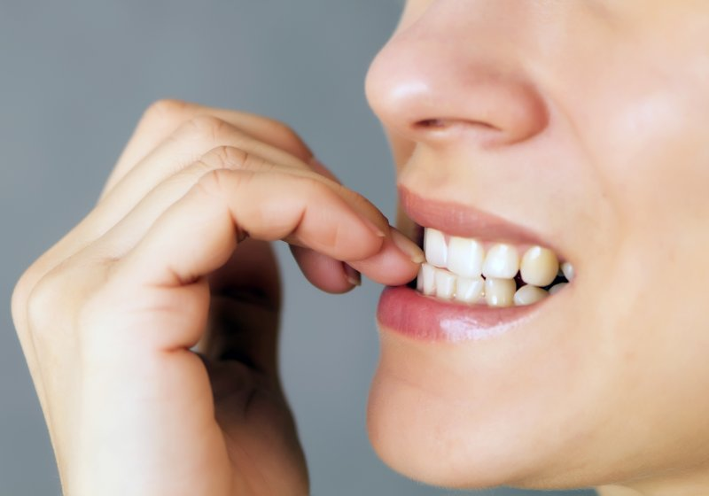 person biting their fingernails